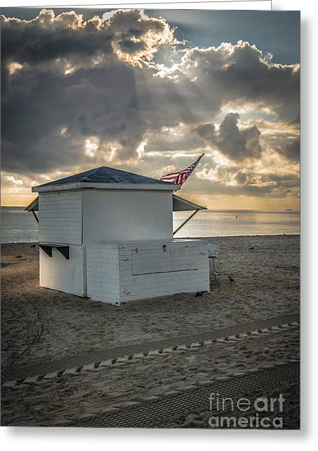 Early Morning Sun Greeting Cards - US Flag on Beach Hut illuminated by early morning sun Greeting Card by Ian Monk