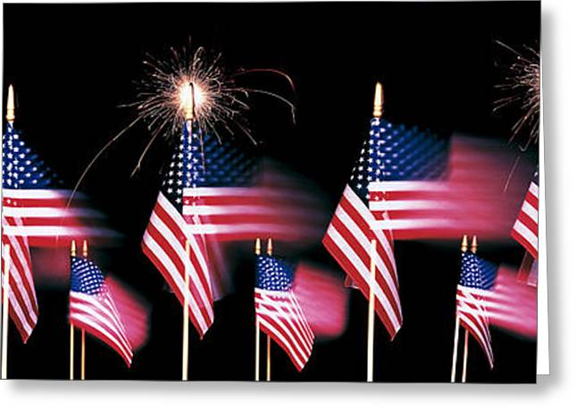 July 4th Photographs Greeting Cards - Us Flags And Fireworks Greeting Card by Panoramic Images