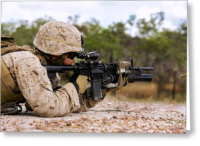 Shoulder-fired Greeting Cards - U.s. Marine Fires Rounds Down Range Greeting Card by Stocktrek Images