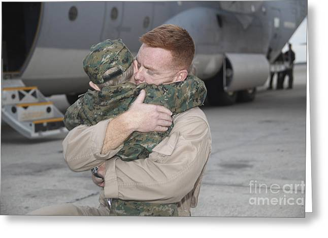 Family With One Child Greeting Cards - U.s. Marine Hugs His 4-year-old Son Greeting Card by Stocktrek Images