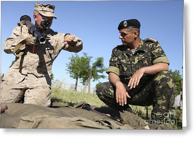 Cooperation Greeting Cards - U.s. Marine Learns The Details Greeting Card by Stocktrek Images
