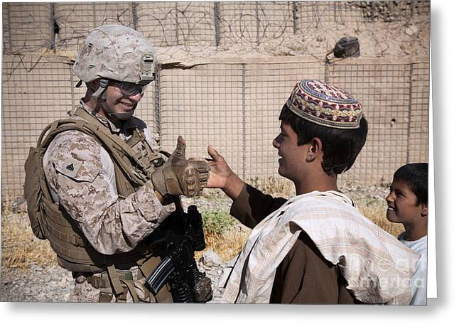 Shaking Hands Greeting Cards - U.s. Marine Thumb Wrestles With An Greeting Card by Stocktrek Images