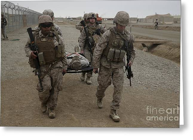Military Base Greeting Cards - U.s. Marines And Navy Corpsmen Evacuate Greeting Card by Stocktrek Images