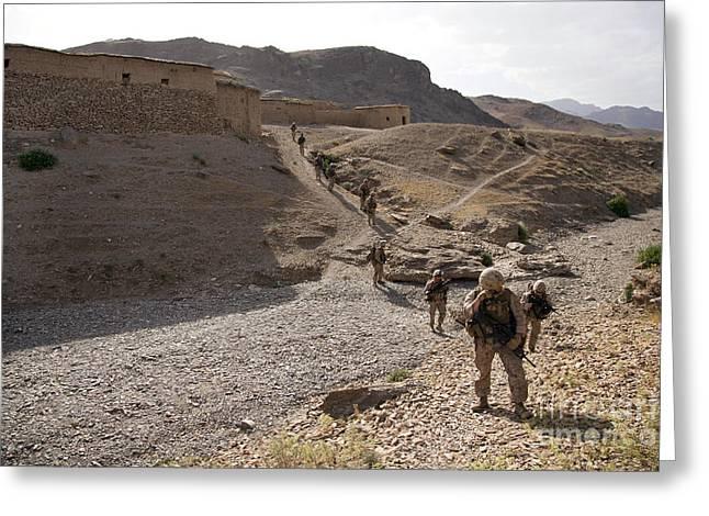 Nato Greeting Cards - U.s. Marines Patrol Through A Village Greeting Card by Stocktrek Images