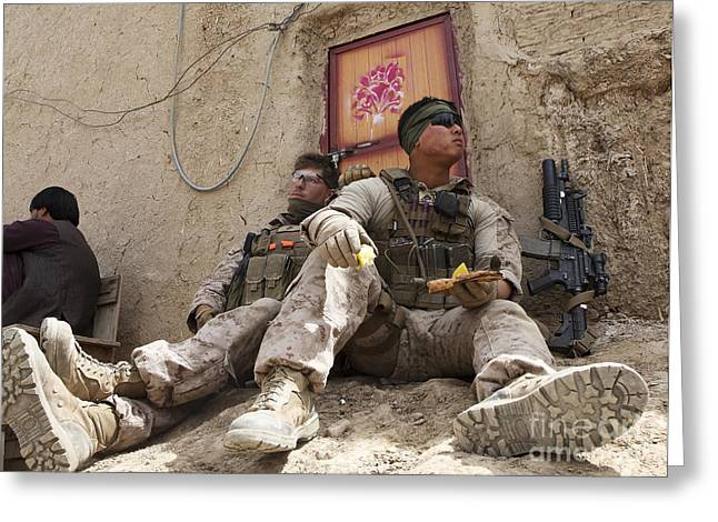 Helmand Province Greeting Cards - U.s. Marines Take A Break In The Kajaki Greeting Card by Stocktrek Images