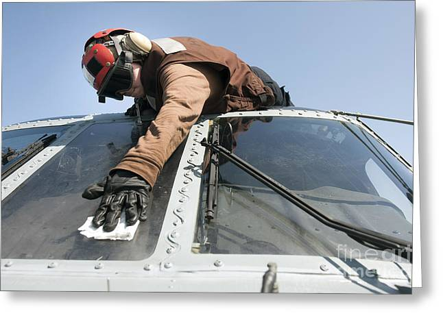 Scrubbing Greeting Cards - U.s. Navy Airman Cleans The Windshield Greeting Card by Stocktrek Images