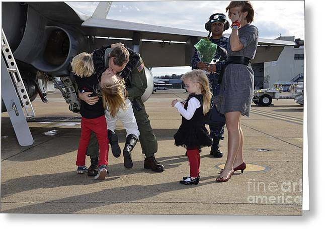 Caring Mother Greeting Cards - U.s. Navy Aviator Is Reunited Greeting Card by Stocktrek Images