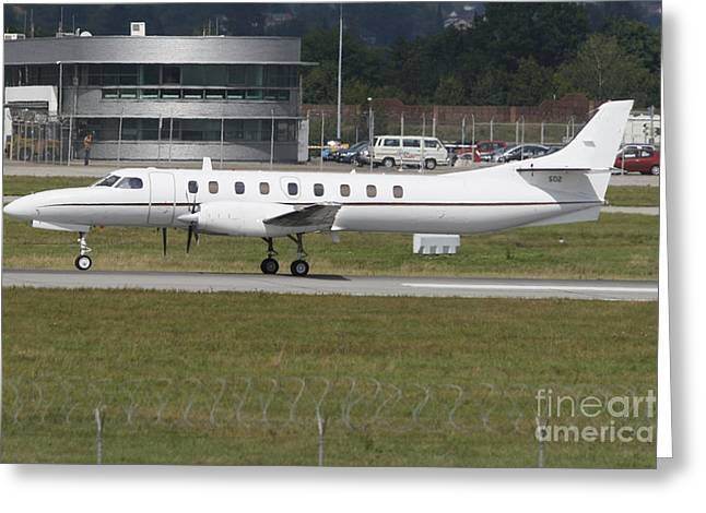 Taxiing Greeting Cards - U.s. Navy C-26d Metroliner Taxiing Greeting Card by Timm Ziegenthaler