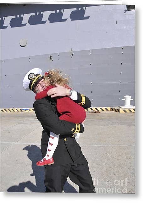 Family With One Child Greeting Cards - U.s. Navy Commander Hugs His Daughter Greeting Card by Stocktrek Images