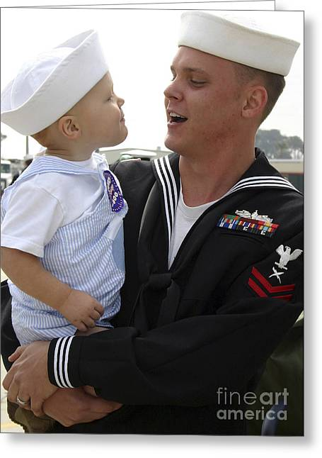 Family With One Child Greeting Cards - U.s. Navy Sailor Embraces His Son Greeting Card by Stocktrek Images