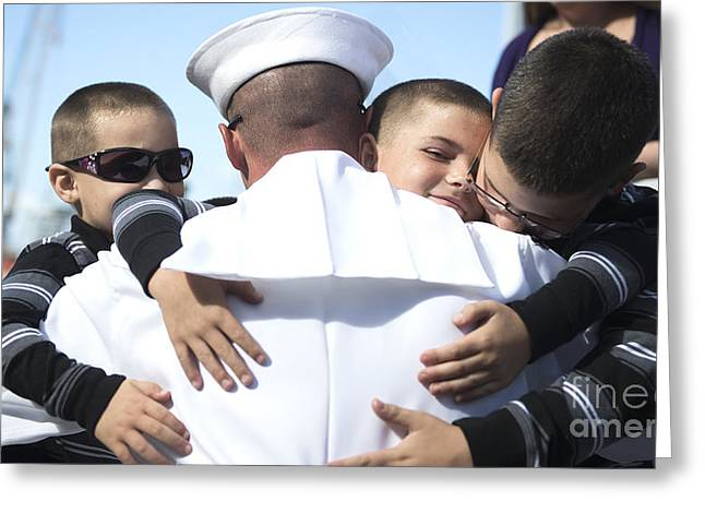 Arm Around Boy Greeting Cards - U.s. Navy Sailor Embraces His Sons Greeting Card by Stocktrek Images