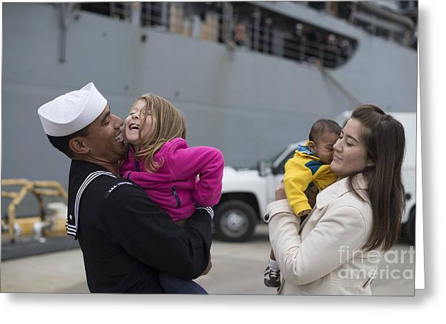 Recently Sold -  - Caring Mother Greeting Cards - U.s. Navy Sailor Greets His Family Greeting Card by Stocktrek Images