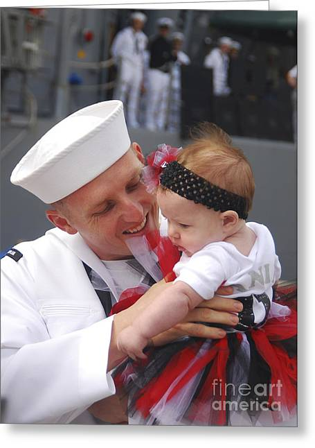 Family With One Child Greeting Cards - U.s. Navy Sailor Hugs His Baby Daughter Greeting Card by Stocktrek Images
