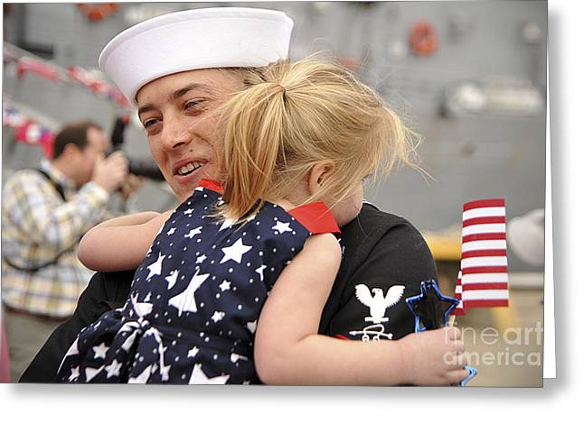 Family With One Child Greeting Cards - U.s. Navy Sailor Hugs His Daughter Greeting Card by Stocktrek Images