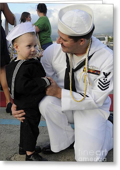 Family With One Child Greeting Cards - U.s. Navy Sailor Hugs His Son Greeting Card by Stocktrek Images