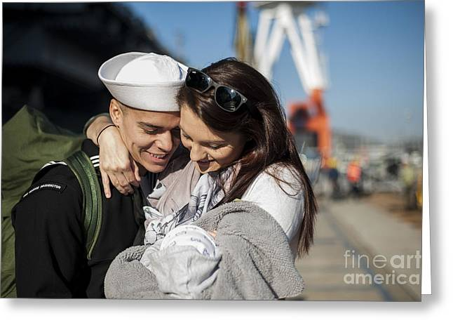 Family With One Child Greeting Cards - U.s. Navy Sailor Hugs His Wife Greeting Card by Stocktrek Images