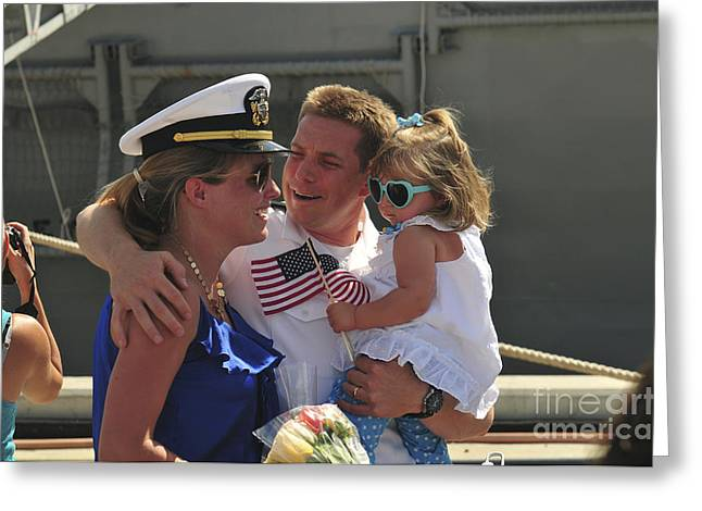 Family With One Child Greeting Cards - U.s. Navy Sailor Is Greeted By His Wife Greeting Card by Stocktrek Images