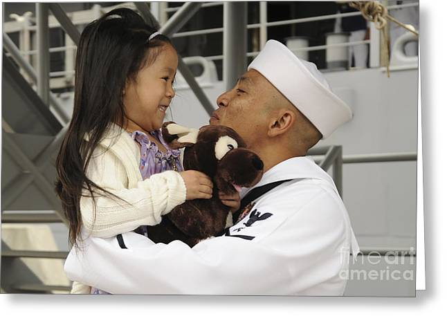 Family With One Child Greeting Cards - U.s Navy Sailor Receives A Hug Greeting Card by Stocktrek Images