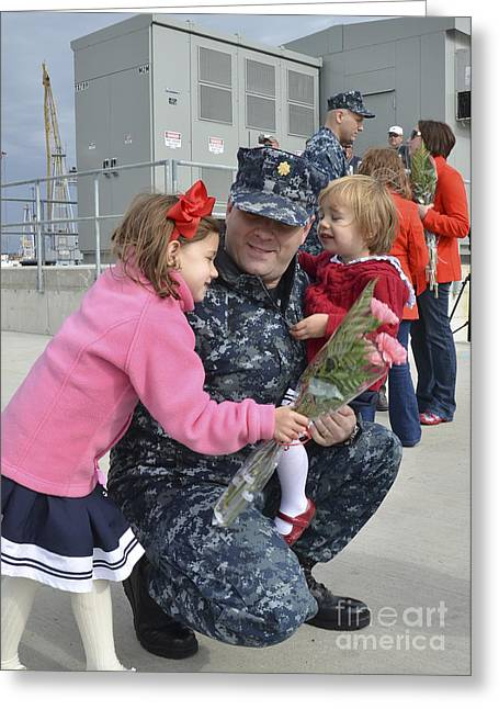 One Parent Greeting Cards - U.s. Navy Sailors Embrace Their Loved Greeting Card by Stocktrek Images