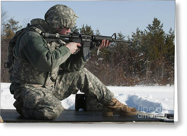 Mccoy Greeting Cards - U.s. Soldier Fires His M4a3 Carbine Greeting Card by Stocktrek Images