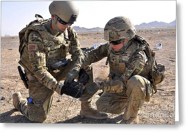 Risk Security Greeting Cards - U.s. Soldiers Use Tape To Wrap Greeting Card by Stocktrek Images