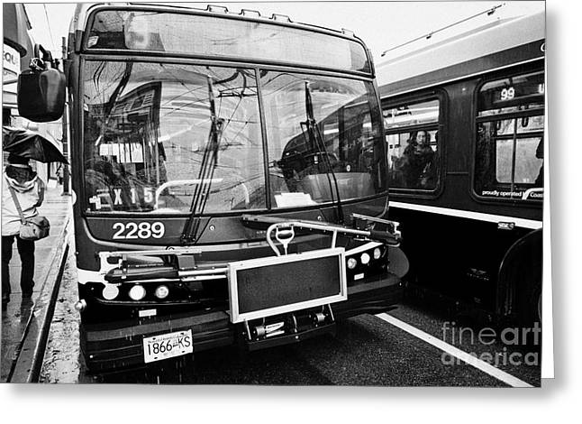 North Vancouver Greeting Cards - Vancouver busses at bustop passing on a wet rainy day BC Canada Greeting Card by Joe Fox