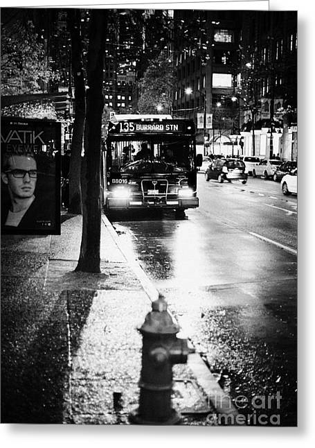 Busstop Greeting Cards - Vancouver city bus at stop on wet street in early evening in downtown city centre BC Canada Greeting Card by Joe Fox