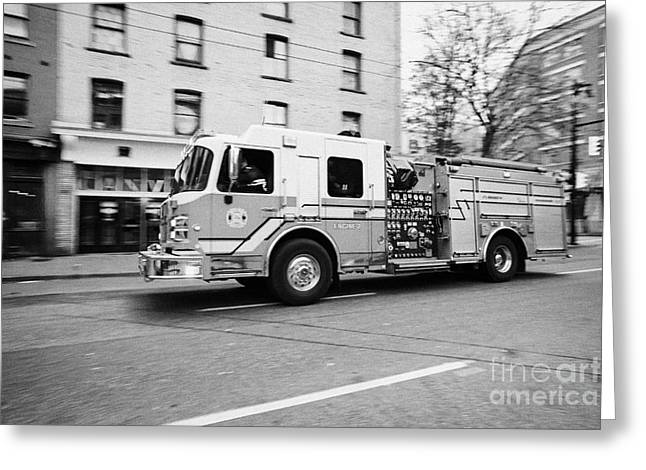 Vancouver fire rescue services truck engine 2 speeding through downtown city streets BC Canada delib Greeting Card by Joe Fox