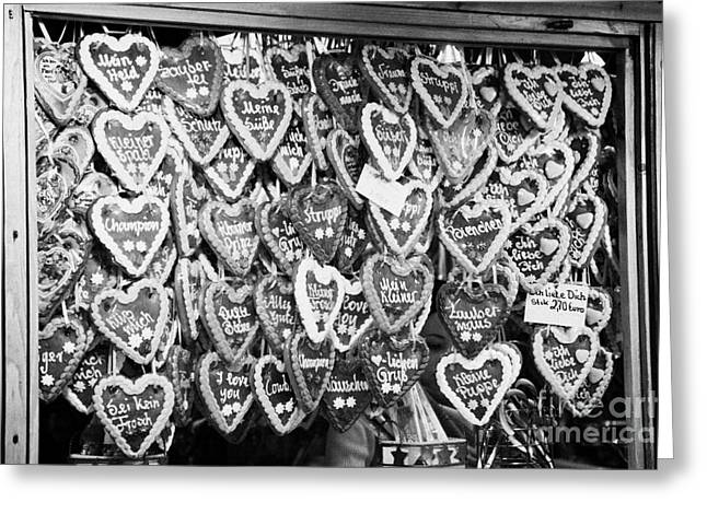 Berlin Germany Greeting Cards - various Lebkuchen hearts hang for sale from a stall in the christmas market Berlin Germany Greeting Card by Joe Fox