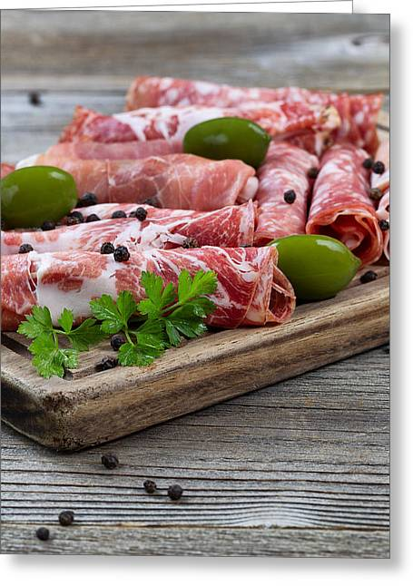 Deli Greeting Cards - Various meats on serving board with rustic background  Greeting Card by Tom  Baker
