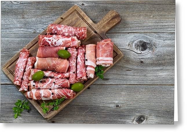 Deli Greeting Cards - Various raw meats on rustic serving board  Greeting Card by Tom  Baker