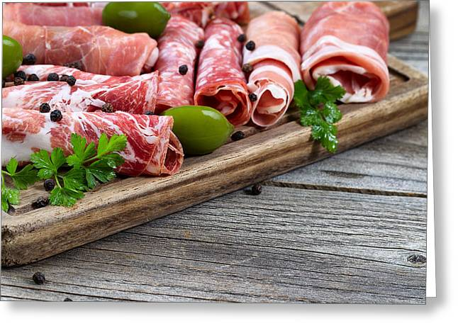 Deli Greeting Cards - Various raw meats on serving board with rustic background  Greeting Card by Tom  Baker