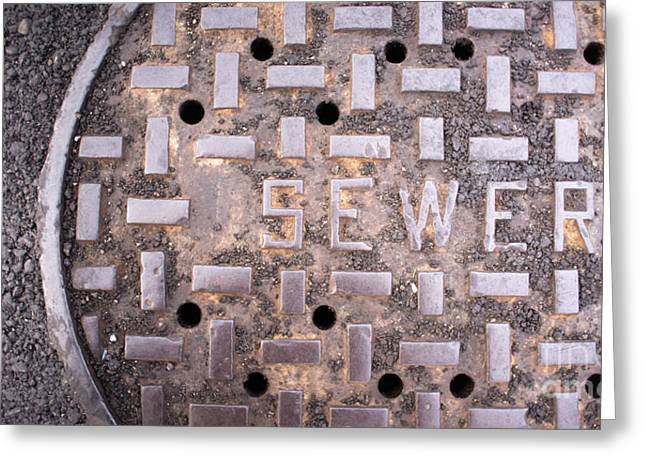 Underground Utilities Greeting Cards - Vented Manhole Sewer Main Cover Asphalt Side Street Water Drain Greeting Card by Christopher Boswell