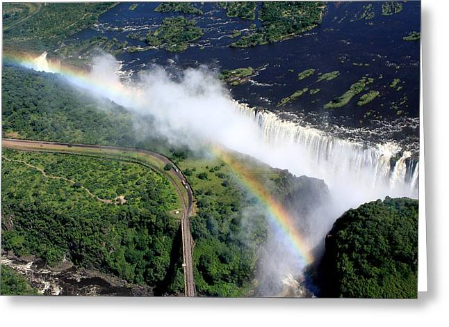 Zambia Waterfall Greeting Cards - Rainbow Over Victoria Falls  Greeting Card by Aidan Moran