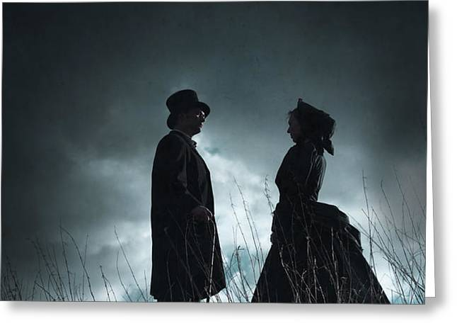 victorian couple face on another before a stormy sky Greeting Card by Lee Avison