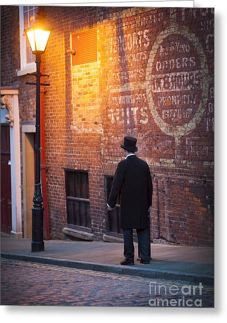 Streetlight Greeting Cards - Victorian Man On A Cobbled Street At Night Greeting Card by Lee Avison