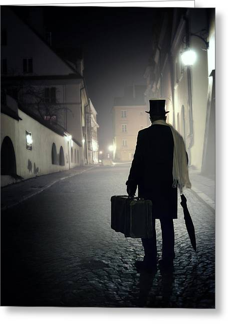 18th Century Greeting Cards - Victorian man with top hat carrying a suitcase walking in the old town at night Greeting Card by Jaroslaw Blaminsky