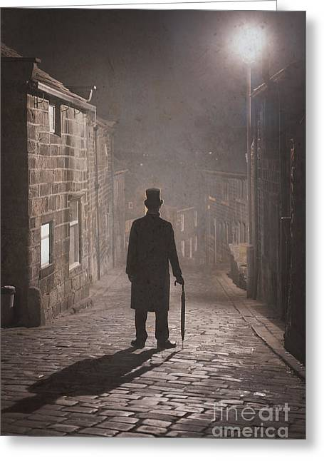 Victorian Man With Top Hat On A Cobbled Street At Night In Fog Greeting Card by Lee Avison