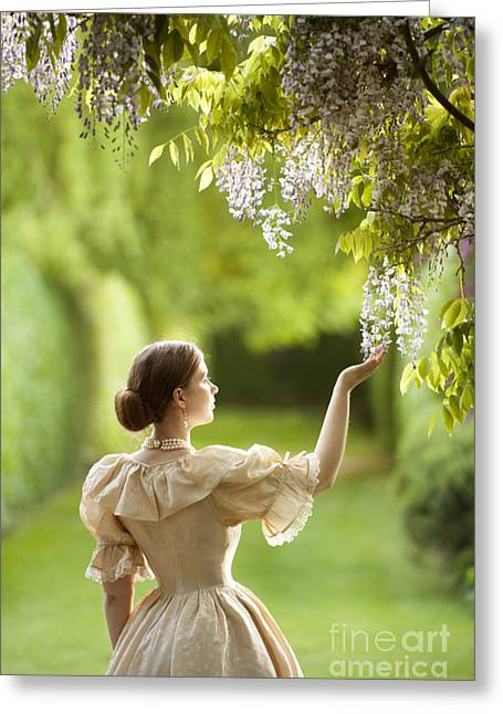 Wisteria In Bloom Greeting Cards - Victorian Woman In A Garden With Wisteria Flowers Greeting Card by Lee Avison