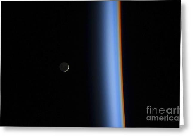Emergence Greeting Cards - View Of A Crescent Moon Rising Greeting Card by Stocktrek Images