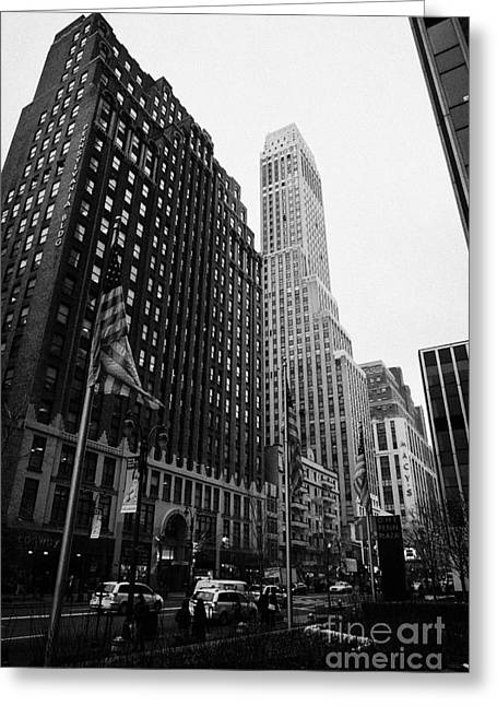 Manhatan Greeting Cards - view of pennsylvania bldg nelson tower and US flags flying on 34th street from 1 penn plaza Greeting Card by Joe Fox