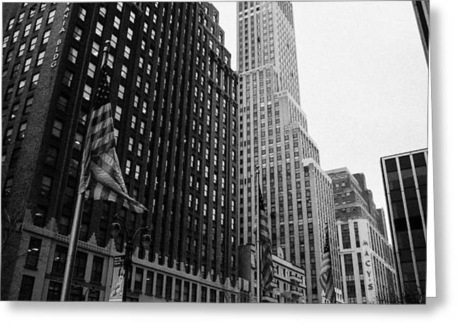 view of pennsylvania bldg nelson tower and US flags flying on 34th street from 1 penn plaza Greeting Card by Joe Fox