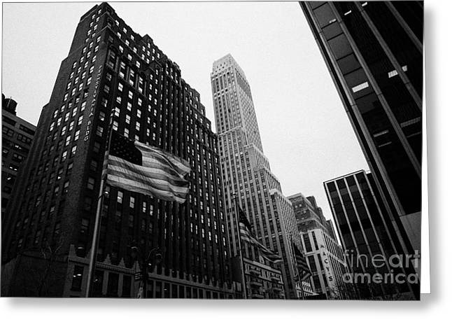 Manhaten Greeting Cards - view of pennsylvania bldg nelson tower and US flags flying on 34th street from 1 penn plaza nyc Greeting Card by Joe Fox