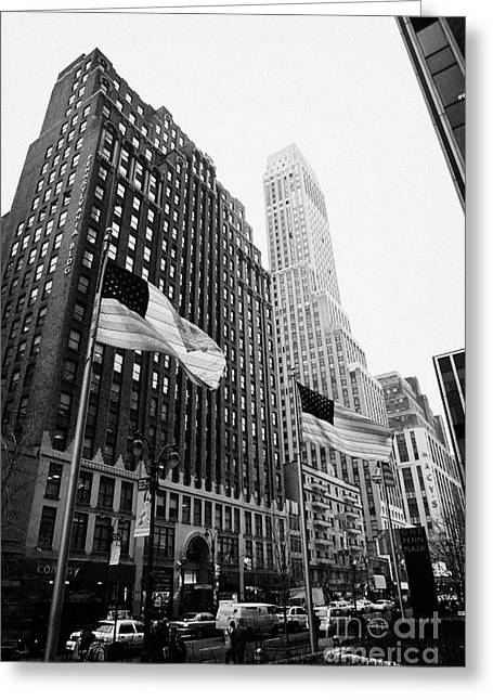 Manhatan Greeting Cards - view of pennsylvania bldg nelson tower and US flags flying on 34th street new york city Greeting Card by Joe Fox