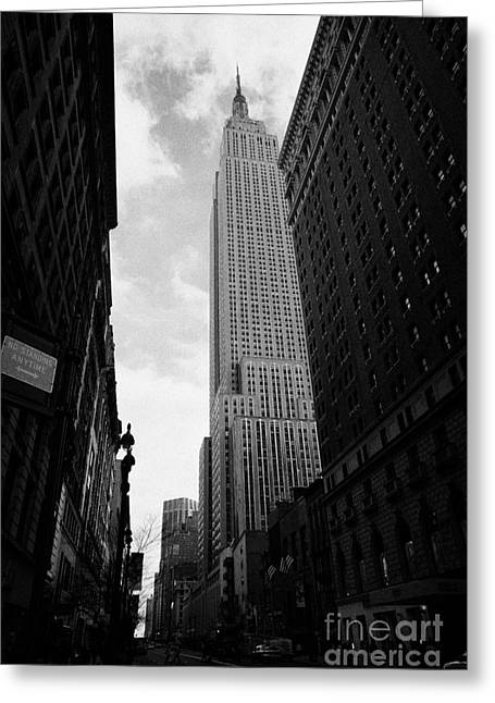 Manhatan Greeting Cards - View of the empire state building from West 34th Street and Broadway junction new york city Greeting Card by Joe Fox