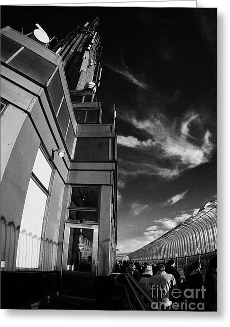 Manhatan Greeting Cards - View Of The Top Of The Empire State Building Radio Mast And Tourists On Observation Deck New York Greeting Card by Joe Fox