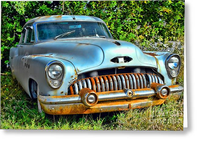 Rusted Cars Photographs Greeting Cards - Vintage American Car in Yard Greeting Card by Olivier Le Queinec