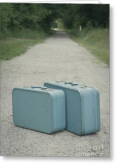 Road Travel Greeting Cards - Vintage blue suitcases on a gravel road Greeting Card by Edward Fielding
