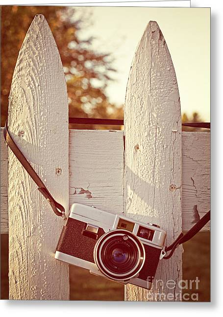 White Picket Fence Greeting Cards - Vintage film camera on picket fence Greeting Card by Edward Fielding