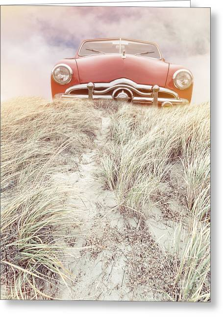 Car Park Greeting Cards - Vintage red car in the sand dunes Greeting Card by Edward Fielding